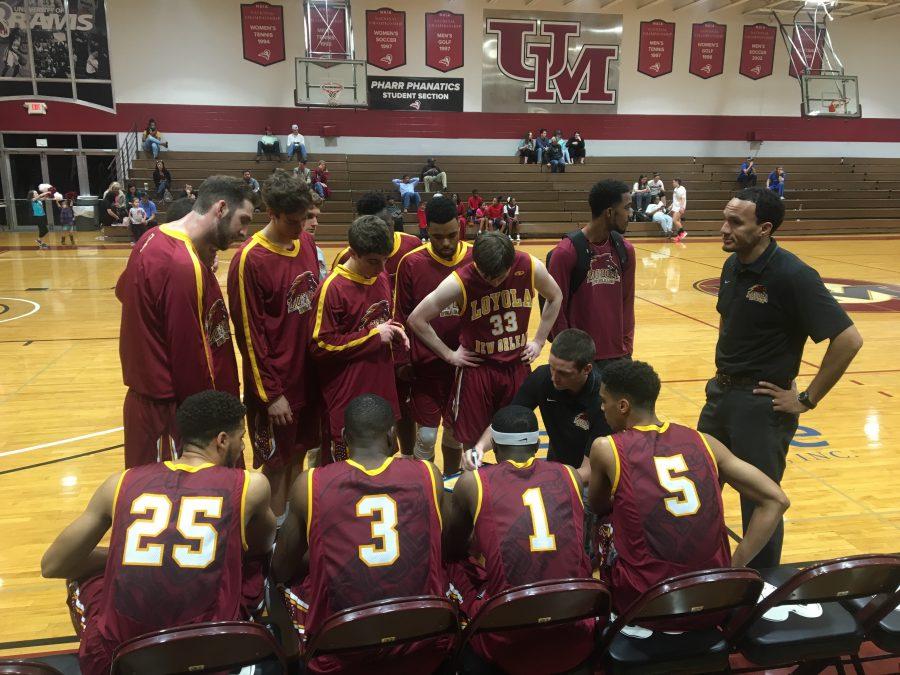 Loyola men's basketball team huddles before the start of their game against the University of Mobile on Jan. 12. Photo credit: Caroline Gonzalez