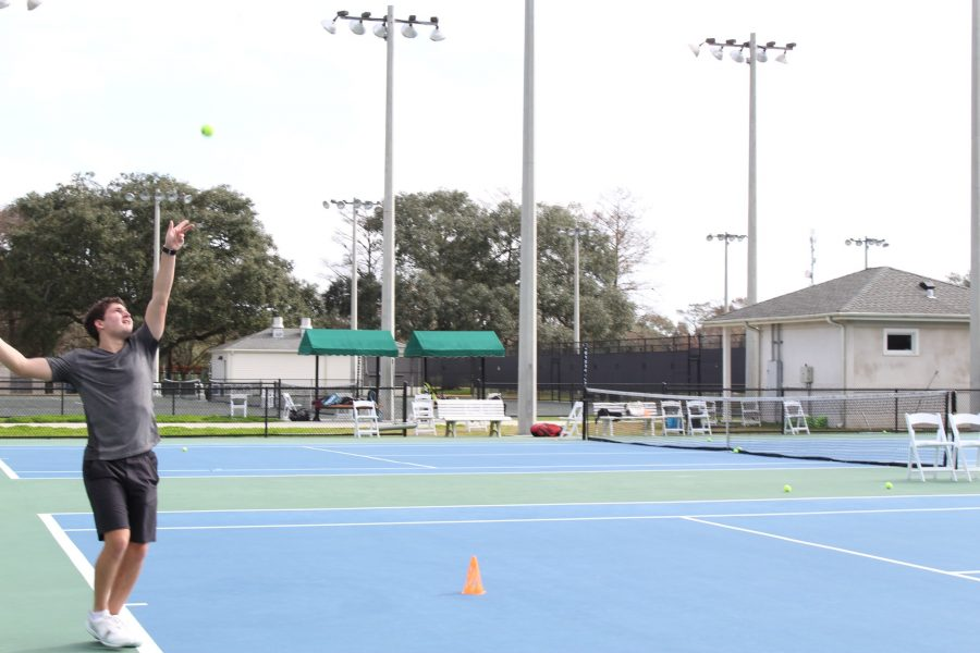 Anthony+Zaleski%2C+biology+junior+practices+his+serve+in+City+Park.+The+spring+season+starts+on+Jan.+27+against+Mississippi+Gulf+Coast+Community+College+at+City+Park+Tennis+Center.+Photo+credit%3A+Alliciyia+George