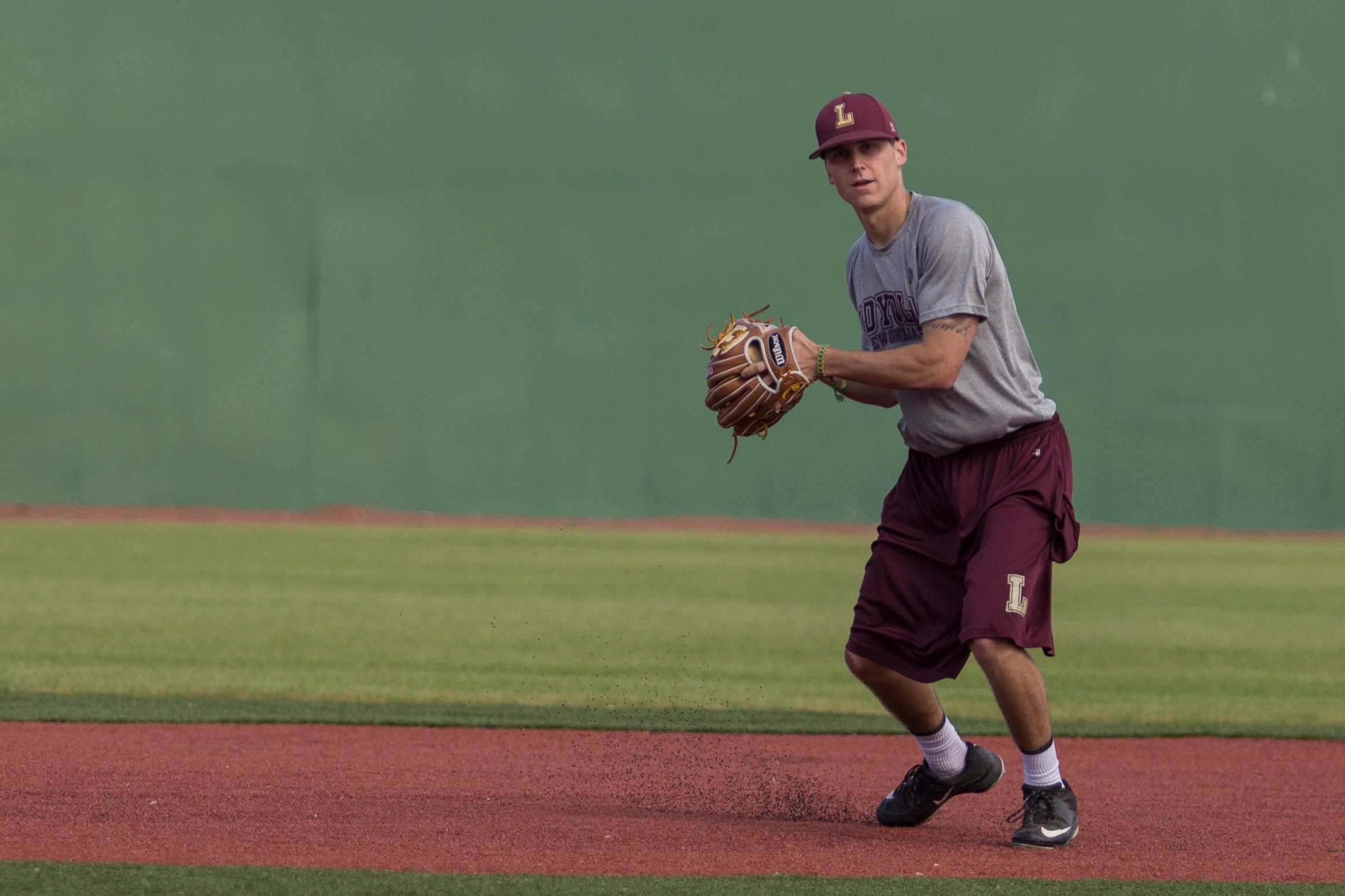 Blake Toscano, Loyola Wolfpack shortstop and business major, throws a baseball during practice, at the John A. Alario Sr. Event Center baseball diamond in Westwego, January, 14. The senior said he hopes to see some participation from Loyola students during the season. Photo credit: Osama Ayyad