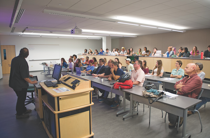 Loyola's Environmental Roundtable meets in Monroe Hall to discuss issues. The discussion covered a range of pressing matters in the environmental sphere.