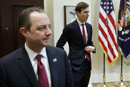 White House Chief of Staff Reince Priebus, left, and Jared Kushner, senior adviser to President Donald Trump, arrive for a meeting with business leaders in the Roosevelt Room of the White House in Washington, Monday, Jan. 30, 2017. (AP Photo/Evan Vucci)