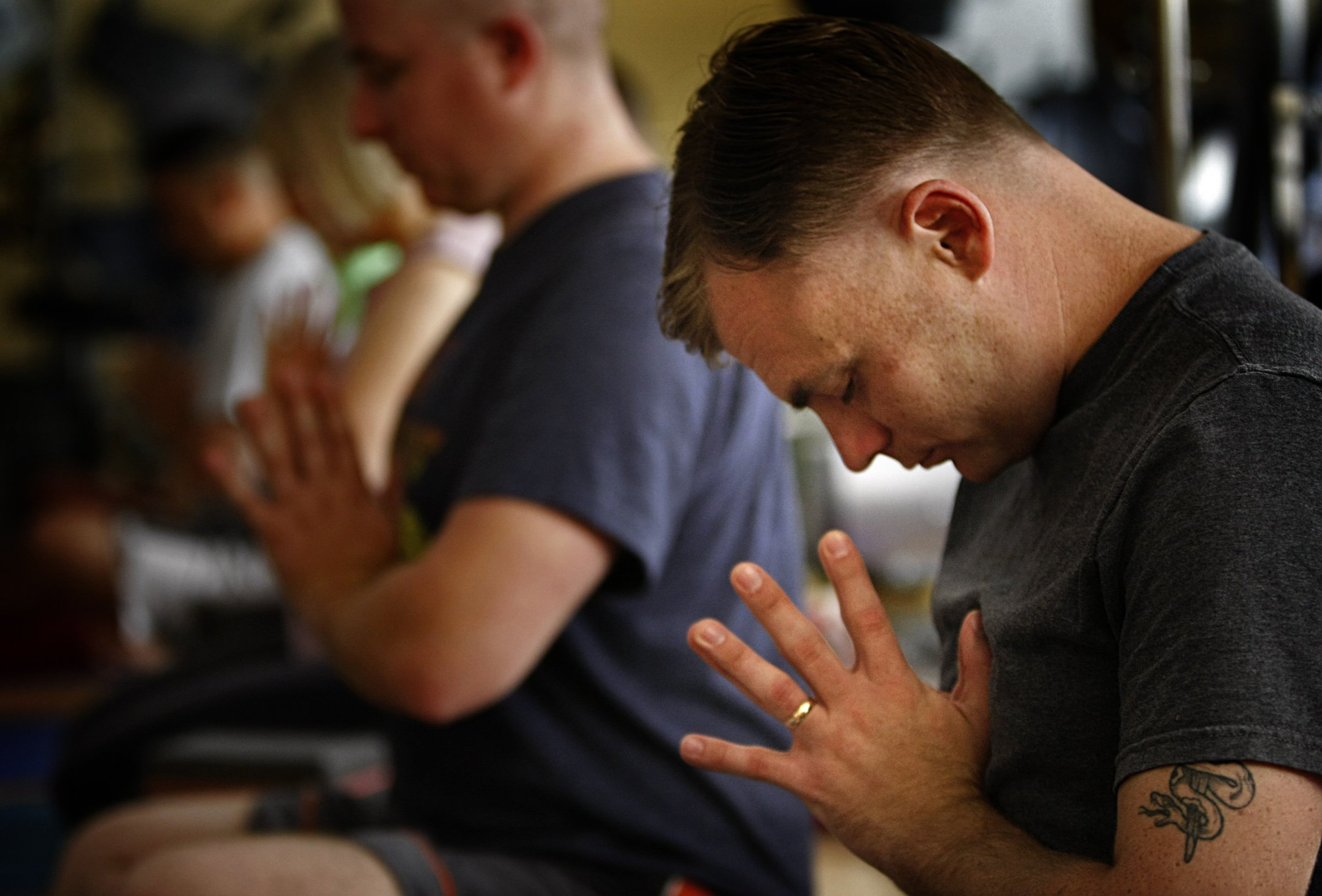 U.S. Marine Sgt. James Bernard, 25, meditates during a yoga class at the Naval Medical Center in San Diego, California, on June 10, 2013. Bernard suffers from PTSD and a traumatic brain injury after deployments to Iraq and Afghanistan. The one-hour yoga class is designed to calm the mind, increase flexibility and improve physical strength. (Don Bartletti/Los Angeles Times/MCT)
