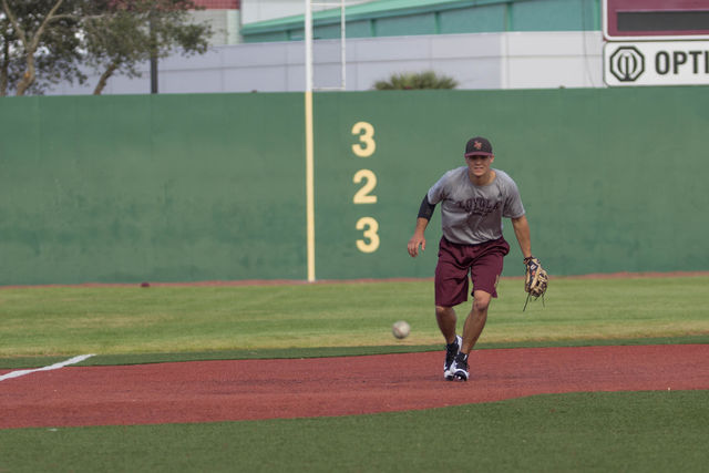 Loyola+Wolfpack+third+baseman+and+junior+Spencer+Rosenbohm%2C+practices+intercepting+a+ground+ball+at+the+John+A.+Alario+Sr.+Event+Center+baseball+diamond+in+Westwego%2C+during+practice+January%2C+14.+Rosenbohm%2C+who+is+pursuing+a+physics+major+said+he+looked+forward+to+the+season.+Photo+credit%3A+Osama+Ayyad