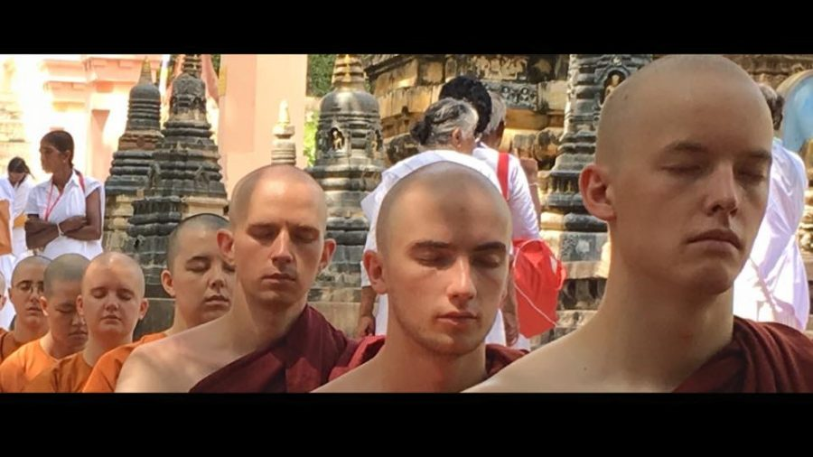 Cyprien Bullock, English junior (second from right) meditates alongside other students during his study abroad program in India. Bullock said his three months at a Buddhist temple made him a more compassionate person. Photo credit: Cyprien Bullock