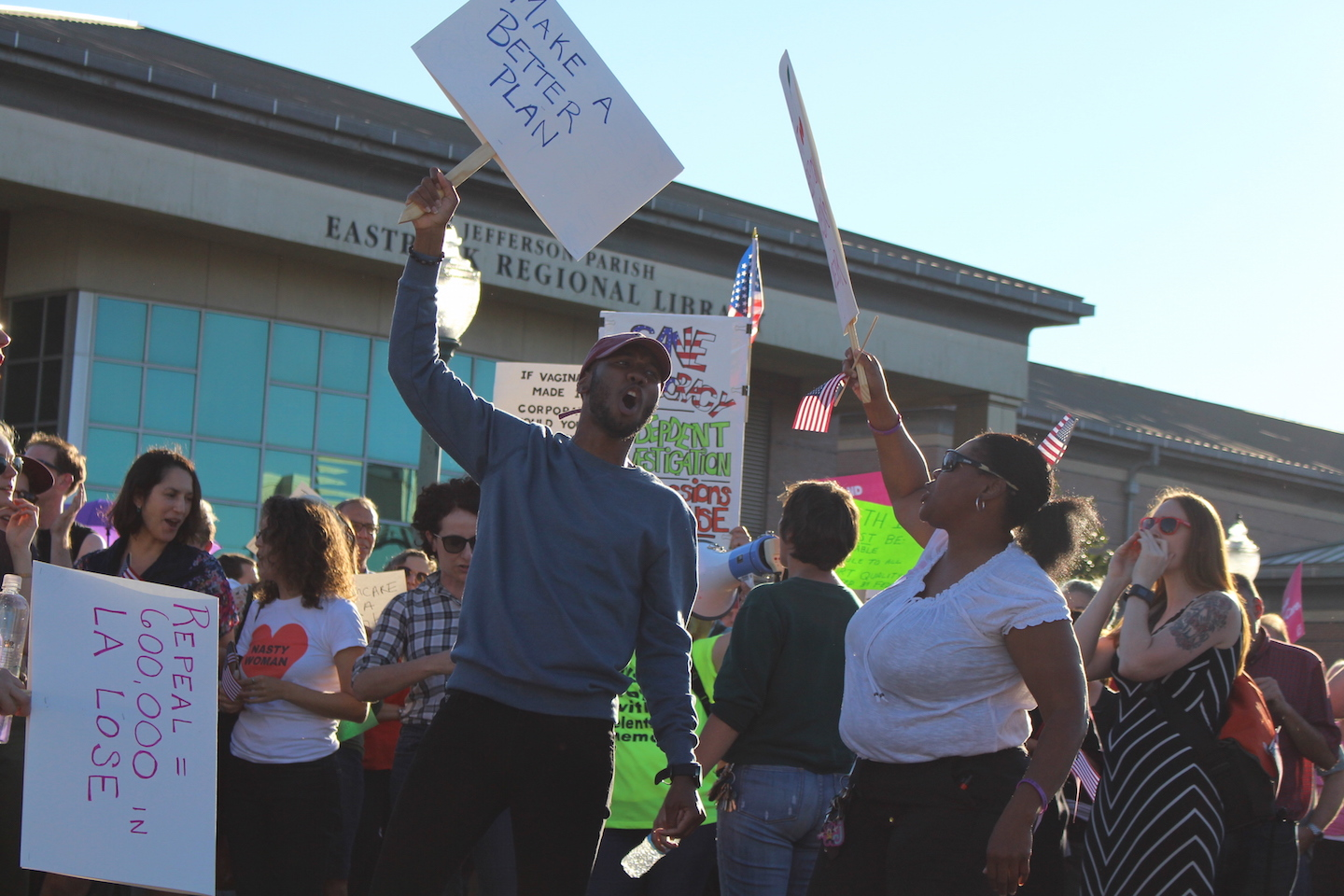 Charles Eden and Jumal Otis play off of each other with chants as they wait for Sen. Bill Cassidy to leave the town hall meeting. Several dozen people gathered around Jefferson Parish Library to give their testimonials in protest to Sen. Bill Cassidy's town hall on Feb. 23, 2017.