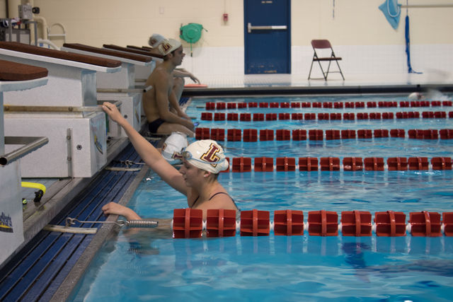 A+Loyola+swimmer+gets+out+of+the+water+after+her+practice.+The+Wolf+Pack+head+to+the+NAIA+Swimming+and+Diving+Championships+on+March+1.+Photo+credit%3A+Tristan+Emmons