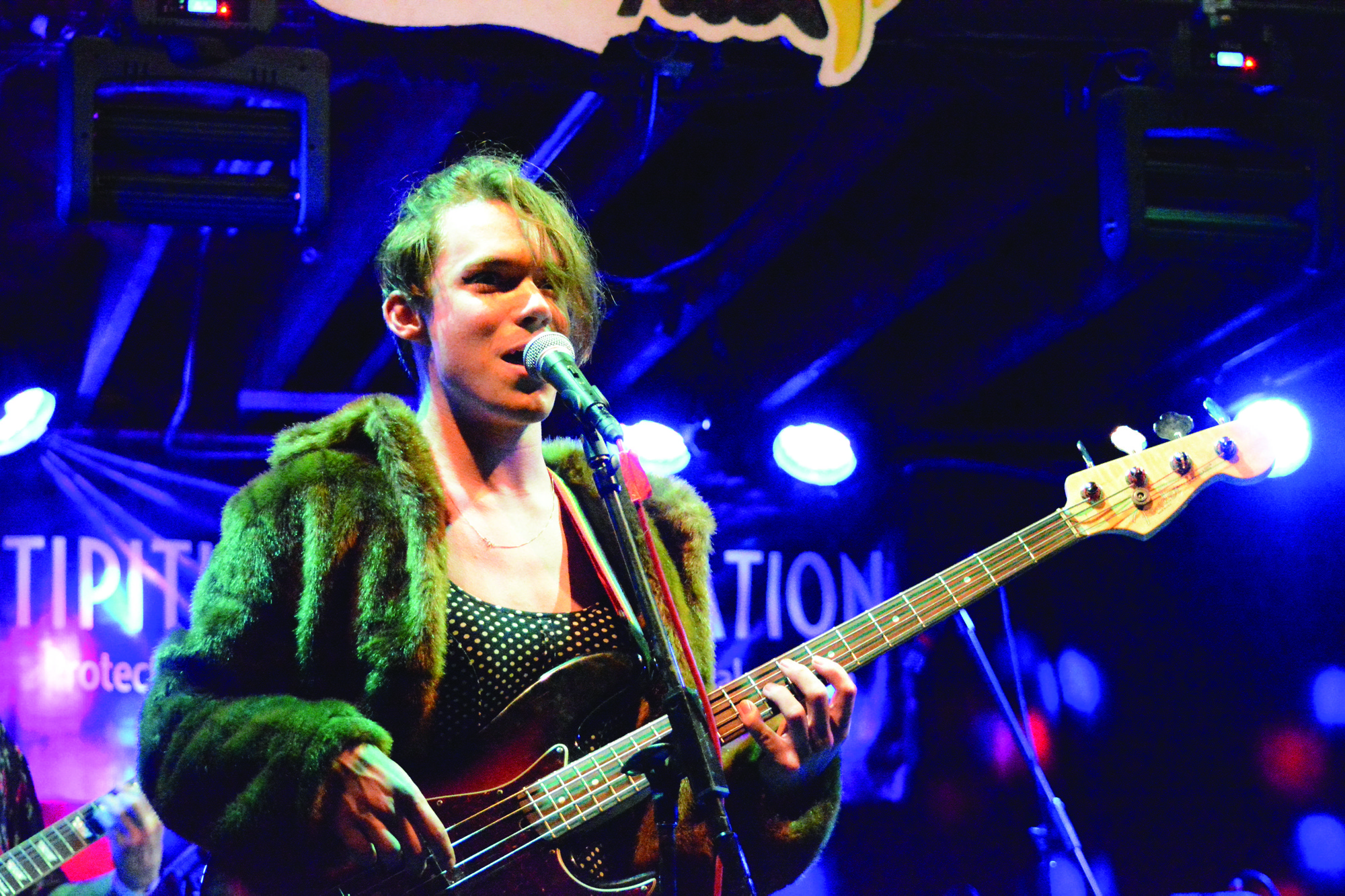 Fionn Hunter-Green, bassist and lead singer of $pare Change performing at Tipitina's. Hunter-Green has been with the band since it's inception in 2014. Photo credit: Davis Walden