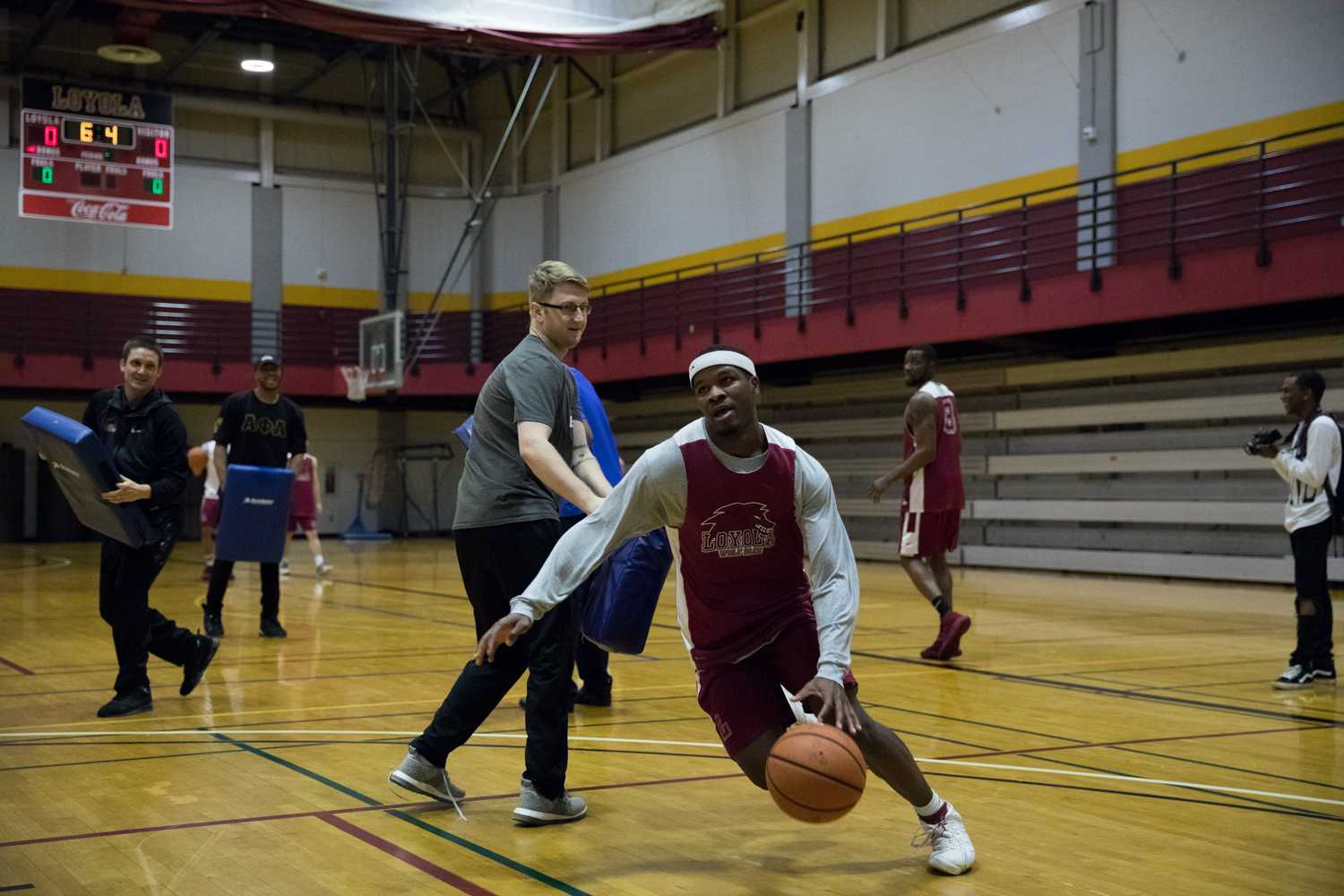 Nick Parker, business junior, races to the hoop during practice on March 10. The Wolf Pack take on the William Penn University Statesmen on Wednesday, March 15 at 8:00 p.m. at Municipal Auditorium in Kansas City, Missouri. Photo credit: Osama Ayyad