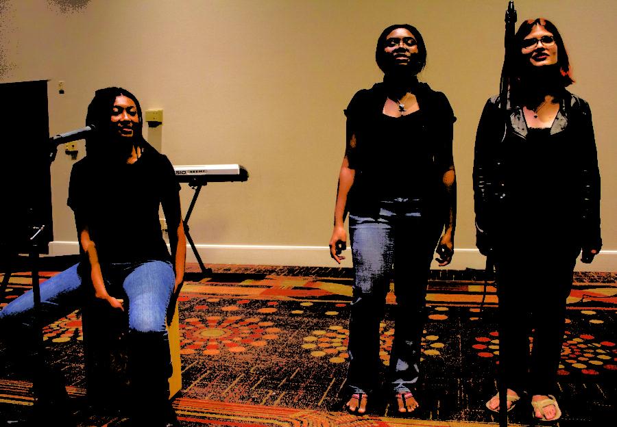 Moresa Robinson music therapy freshman, Rheyanna Lewis biology senior and Alicia Melendez music education junior perform during the Loyola Gospel Festival on Tuesday, Mar. 8, 2017. Photo credit: Alliciyia George