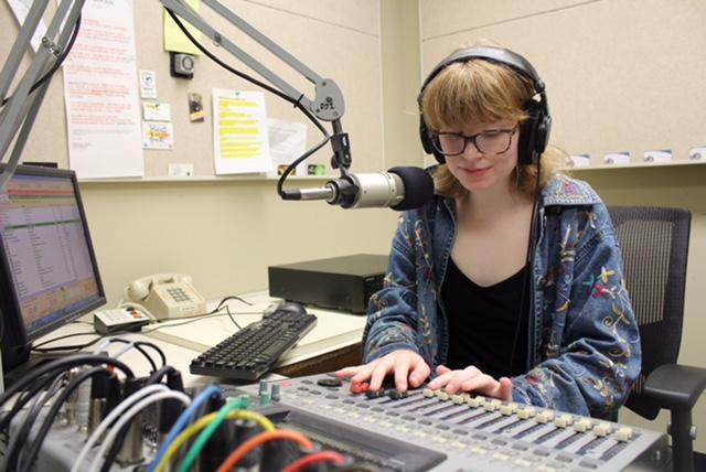 Hannah+Pico%2C+sociology+junior%2C+broadcasts+during+her+Thursday+Hellraiserz+Power+Hour+Show.+Pico+is+conscious+to+include+music+that+celebrates+intersectionality+and+diversity+in+her+music+and+topic+selection.