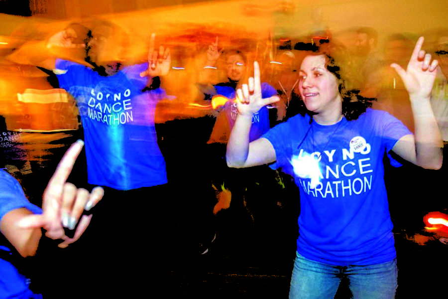 Alumna+Rachel+Comeaux+and+other+students+dance+at+last+year%27s+Dance+Marathon.+This+year%27s+Dance+Marathon+will+occur+April+1.+Photo+credit%3A+Shea+Hermann