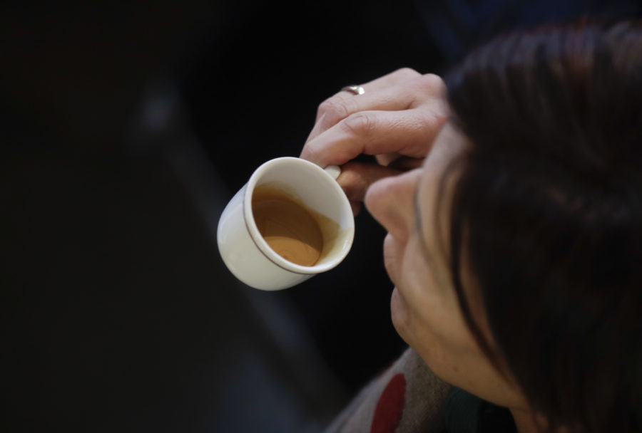 In this image taken on Monday, Feb. 27, 2017, a customer drinks an espresso coffee at a traditional coffee bar in Milan, Italy. Longtime CEO Howard Schultz's vision for Starbucks was largely inspired by the Milan coffee bars he experienced on his first trip to the northern Italian city in 1983. Schultz will continue on with the company to open ''the quintessential Roastery'' in Milan by the end of 2018. (AP Photo/Luca Bruno)