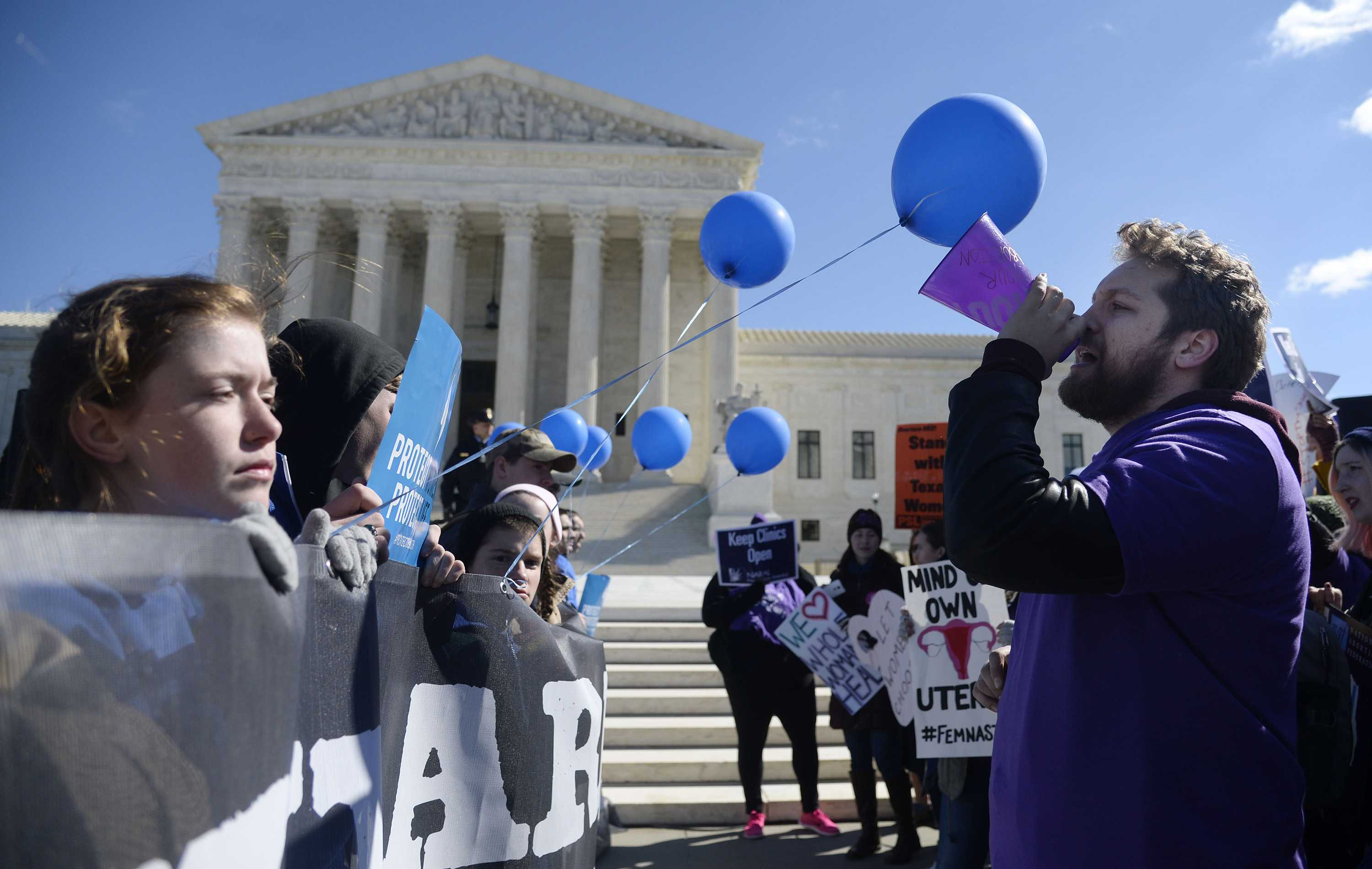 Supporters of legal access to abortion, as well as anti-abortion activists, rally outside the Supreme Court on March 2, 2016, as the Court hears oral arguments in the case of Whole Woman's Health v. Hellerstedt, which deals with access to abortion, in Washington, D.C. (Olivier Douliery/Abaca Press/TNS)