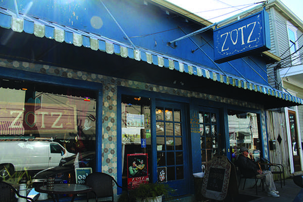 The front window of Zotz, a funky cafe on Oak street, near the Riverbend. Photo credit: Paulina Picciano