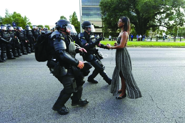 Protestor Ieshia Evans is detained by law enforcement near the headquarters of the Baton Rouge Police Department in Baton Rouge, Louisiana, U.S. July 9, 2016.  REUTERS/Jonathan Bachman