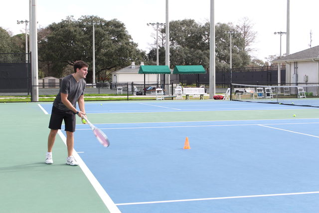 Loyola+tennis+player+prepares+to+serve+the+ball.+The+tennis+team+is+preparing+for+the+conference+championships+on+April+20.+Photo+credit%3A+Alliciyia+George