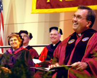 The Rev. Kevin Wildes, S.J., listens to the encouragement of several speakers at his inauguration in Roussel Hall on Oct. 15, 2004. The inauguration included a Mass, ceremony, reception and Collage concert at the end of the night. Photo credit: The Maroon