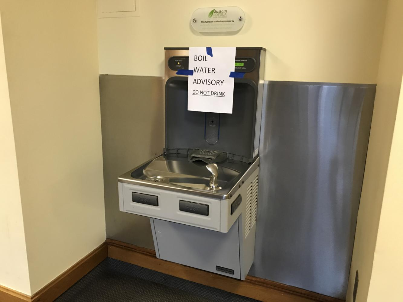 A sign warns not to drink from the water fountains in the Communications and Music Complex on Sept. 20, 2017. Photo credit: Nick Reimann