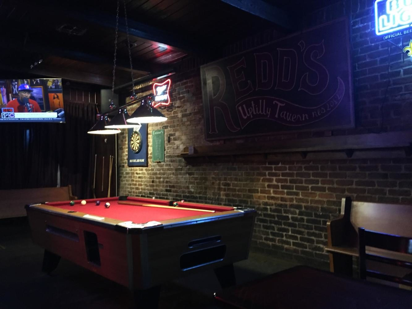 The pool table lays idle within Redd's Uptown Tavern. Reid's is one of several college hangouts on Maple Street. Photo credit: Caleb Beck