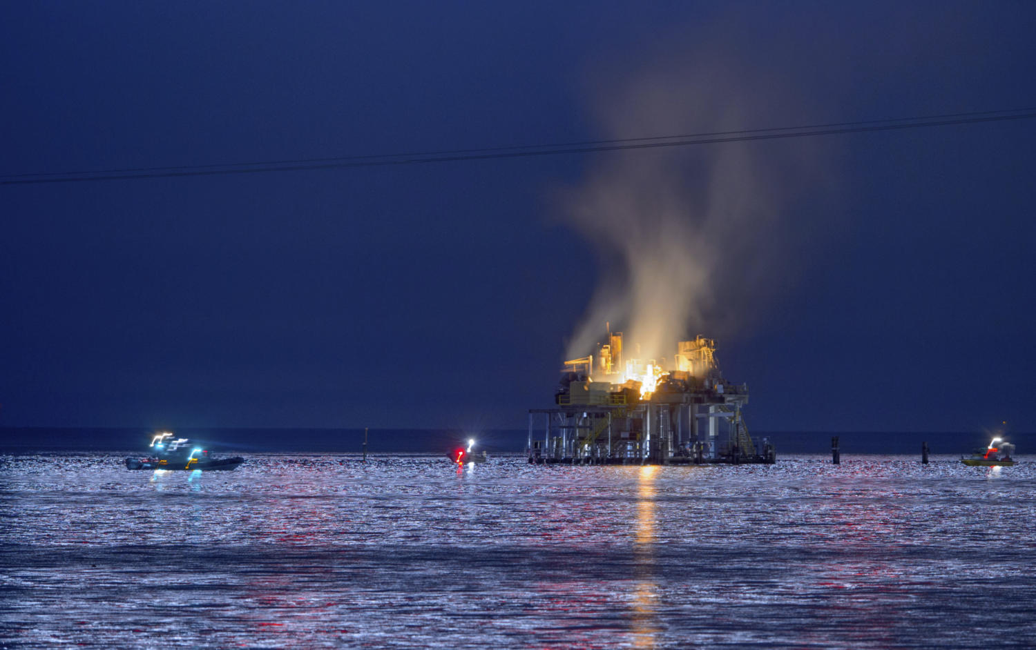 Jefferson Parish, La., authorities and others from other parishes respond to an oil rig explosion in Lake Pontchartrain off Kenner, La., Sunday, Oct. 15, 2017. (Matthew Hinton/The Advocate via AP) Photo credit: Associated Press