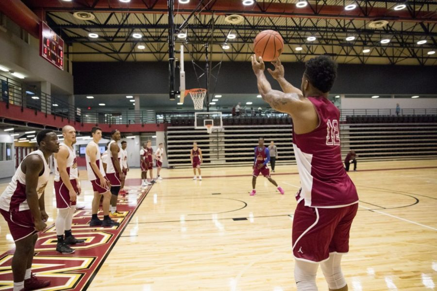 #12 Eric Brown shooting a 3 pointer during a drill. Practice was held in Loyola University Sports Complex. Photo by Jules Santos. Photo credit: Julia Santos