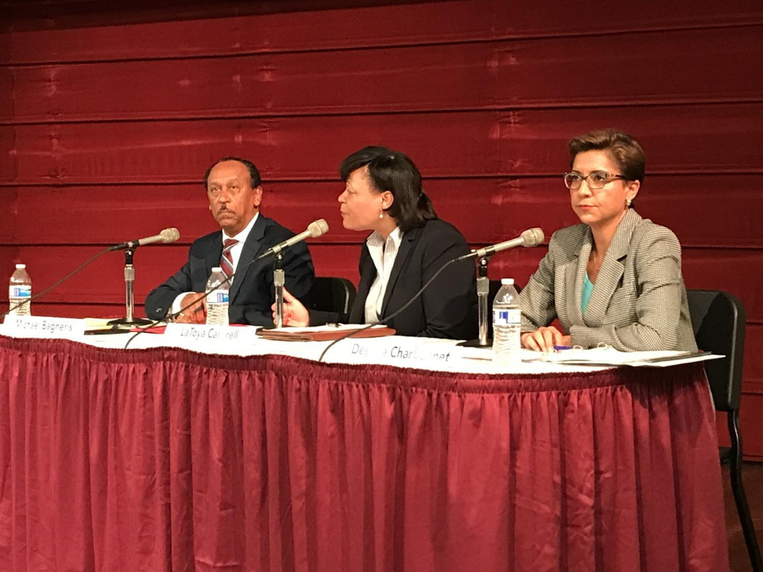 LaToya Cantrell (center) speaks at a forum in Nunemaker Auditorium on Sept. 19, 2017. She was joined by fellow runoff candidate Desiree Charbonnet (right) and third place finisher Michael Bagneris (left). Photo credit: Nick Reimann