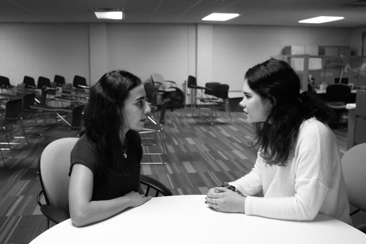 Senators Rana Thabata and Brianna Daniel-Harkins talk after an SGA meeting. Photo credit: Photo illustration by Erin Snodgrass