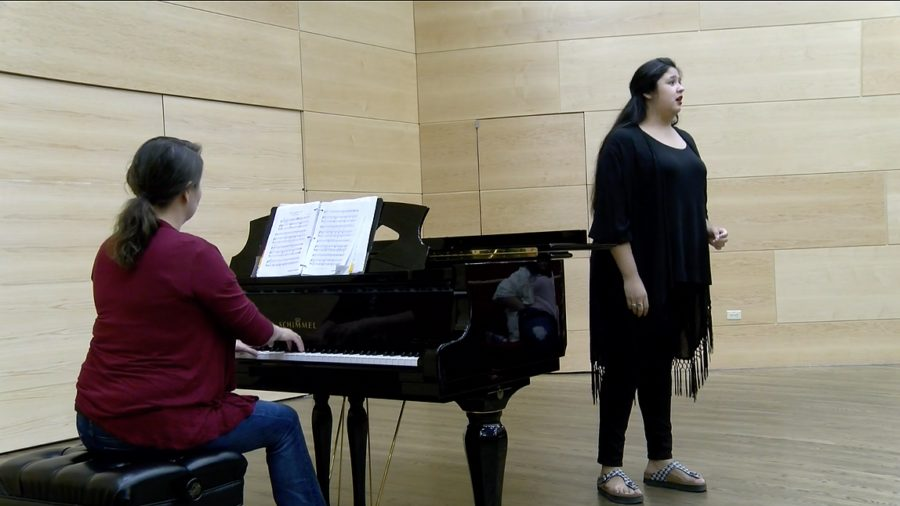 Olivia Garcia singing at an opera recital. Garcia sang in front of her class on Oct. 19, 2017. Photo credit: Sidney Holmes