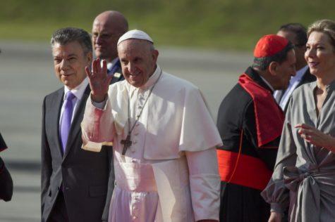 Pope Francis waves next to Colombian President Juan Manuel Santos, left, during his welcoming ceremony upon landing in Bogota, Colombia, on September 6, 2017. (Daniel Garzon Herazo/NurPhoto/Sipa USA/TNS)