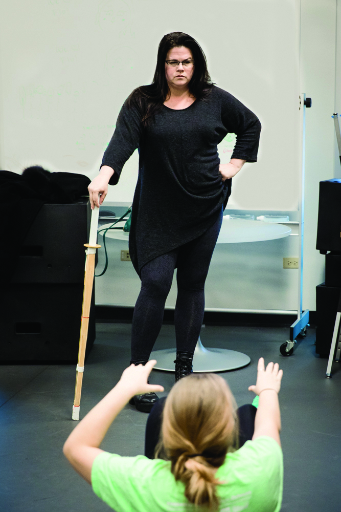 Anne Mahoney, actress and Loyola instructor,  leads a stomp and walk drill in Monroe Hall in New Orleans, La., Dec. 6, 2017 . Mahoney wrote, produced and stars in