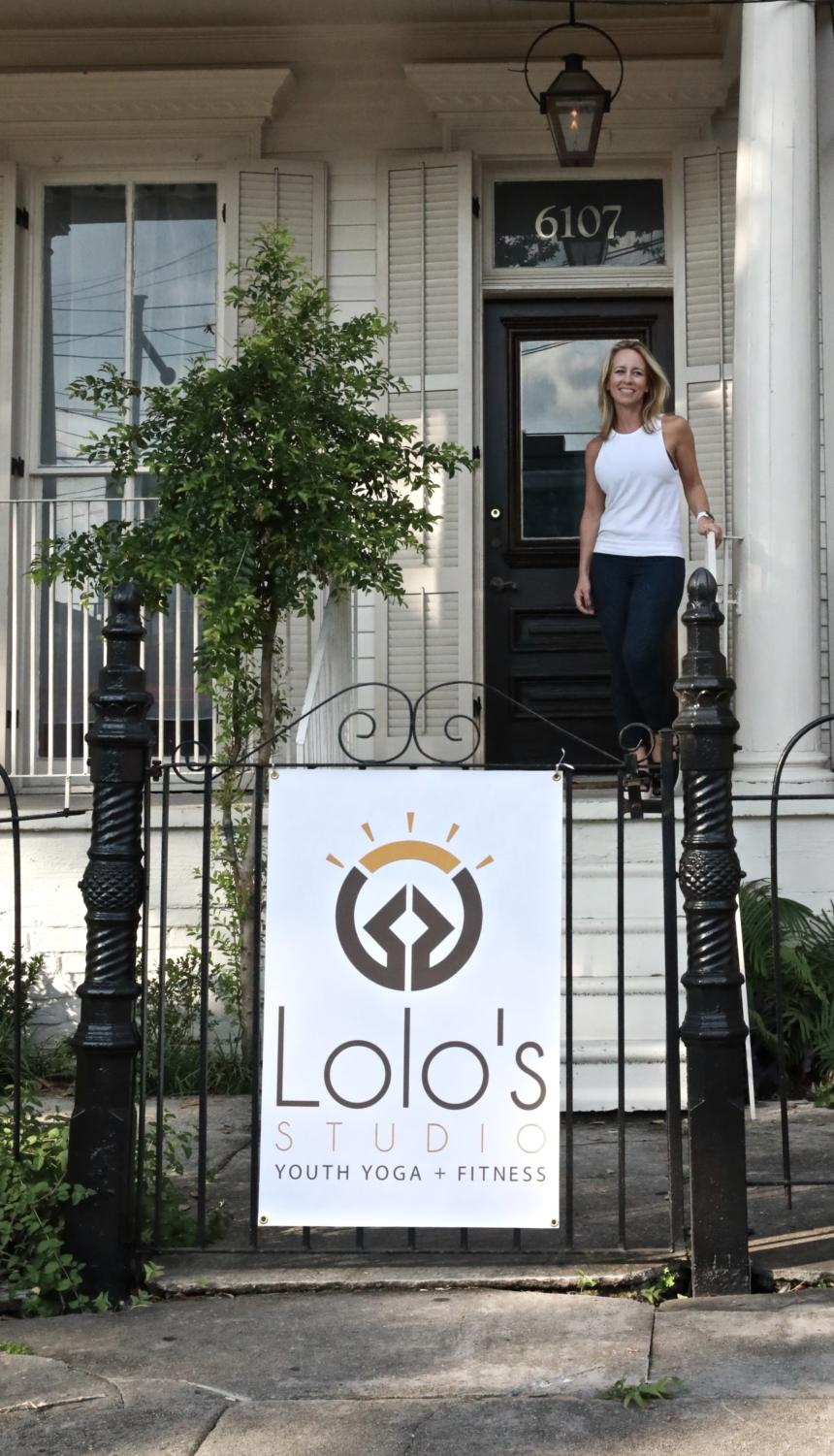 Laurie Azzano, founder of Lolo's Youth Yoga Studio, stands in front of the studio. For her, Lolo's is more than yoga — it's a positive space designed to build strength and confidence. Photo credit: Courtesy of Lolo's Studio