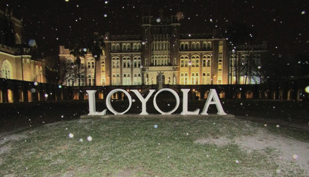 Sleet, not sneaux, falls in front of the Loyola letters at the Horseshoe Jan. 16, 2018. Loyola was the last four-year university in New Orleans to cancel classes for that day. ANDERSON LEAL/The Maroon. Photo credit: Anderson Leal