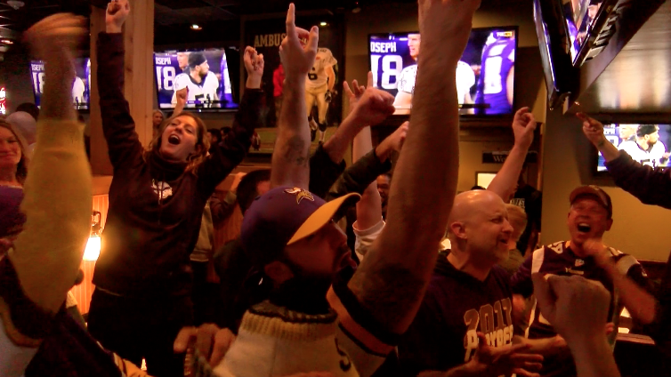 Vikings fans celebrate their team's last second win at Walk On's Bistreaux and Bar on Sunday, Jan. 14, 2018. The Minnesota Vikings beat the New Orleans Saints 29-24 and advance to the NFC Championship game against the Philadelphia Eagles. Photo credit: Brian Wollitz