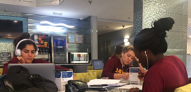 Loyola Volleyball team members work on class assignments Sept. 16, 2017, at Faulkner University in Montgomery, Alabama, before facing   the Faulkner Eagles. Photo credit: Jesse Zabal