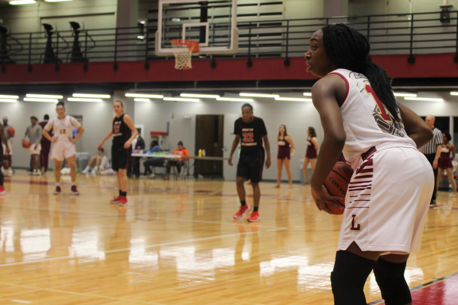 International business sophomore Kaila Anthony (11) looking to send off the inbound pass versus Martin Methodist Feb. 8 2018. Anthony had 15 points in the Wolf Pack win. ANDRES FUENTES/The Maroon.