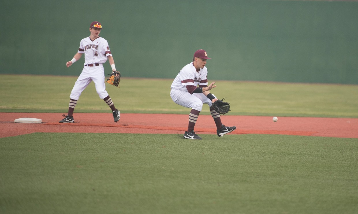 Business freshman Zach Cook (18) and business sophomore Brandon Wilson Jr. (23) stop an offensive play during a game against Louisiana College Feb. 17, 2018, at Signette Field in Westwego, Lousiana. Loyola lost their doubleheader versus the Wildcats at home. LOYOLA NEW ORLEANS ATHLETICS/Courtesy Photo credit: Loyola New Orleans Athletics