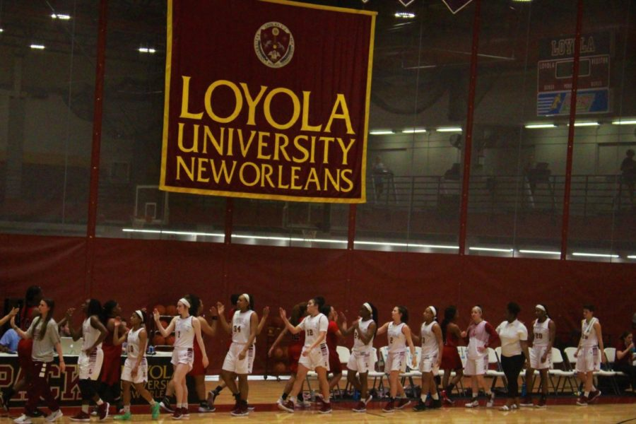 The+Loyola+women%27s+basketball+team+celebrates+their+win+vs.+William+Carey+University+Feb.+22+2018.+The+Wolf+Pack+beat+the+Crusaders+63-54.+Photo+credit%3A+Andres+Fuentes