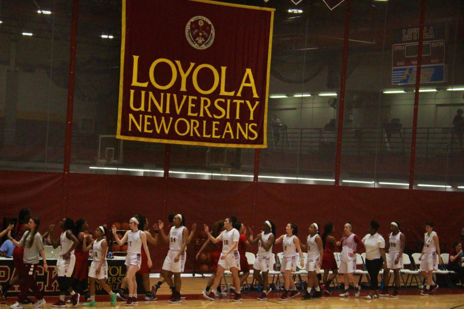 The Loyola women's basketball team celebrates their win vs. William Carey University Feb. 22 2018. The Wolf Pack beat the Crusaders 63-54. Photo credit: Andres Fuentes
