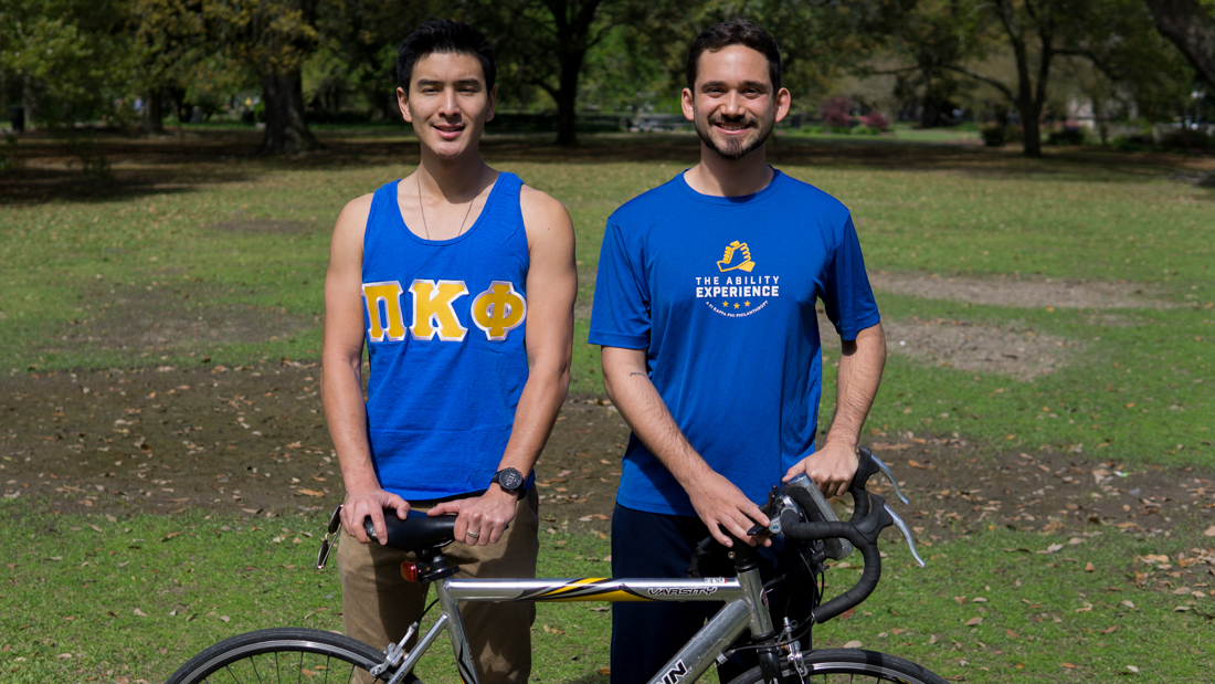 Jared Chan, left, and Bryant Istre, right, pose together with a bicycle, dressed to represent their fraternity, Pi Kappa Phi, and the nonprofit The Ability Experience.  They will be cycling across the State of Florida this summer with other members of the Fraternity to raise money and awareness for the nonprofit. Photo credit: Jacob Meyer