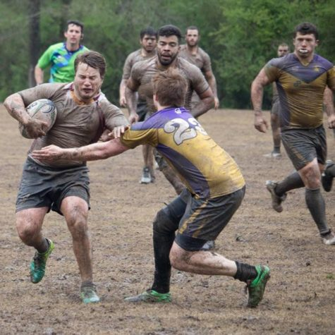 Sean Brennan, mass communication senior, rushing through a Tennessee Tech University player at the National Small College Rugby Organization on March 27, 2018. The Loyola rugby team fell to Tennessee Tech University in the championship round. Photo credit: Seán Brennan