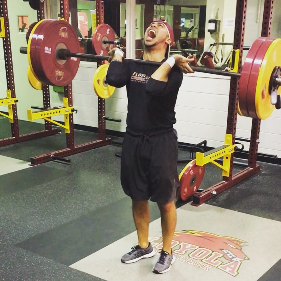 Track+and+field+head+coach+Nick+Dodson+lifts+his+personal+best+260+pounds+in+the+power+clean+this+year.+In+his+second+year+as+coach%2C+Dodson+has+made+it+his+goal+to+workout+with+his+athletes+and+foster+a+family+culture.+NICK+DODSON%2FCourtesy.