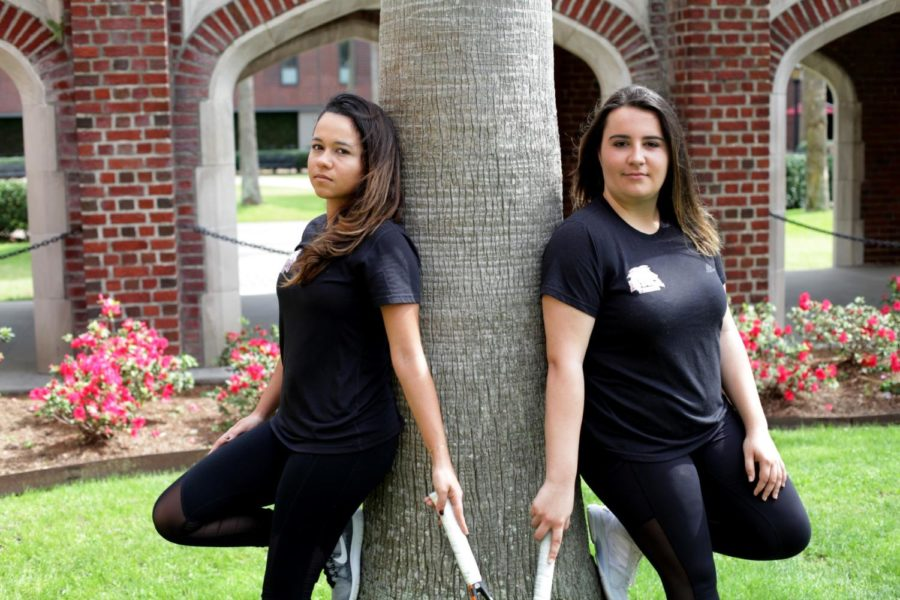 Koral Martinez, biology junior, and Isabel Junqueira, economics junior, are the veteran leaders on the Loyola tennis team. Their friendship stands as a reminder of home for them. Photo credit: Angelo Imbraguglio