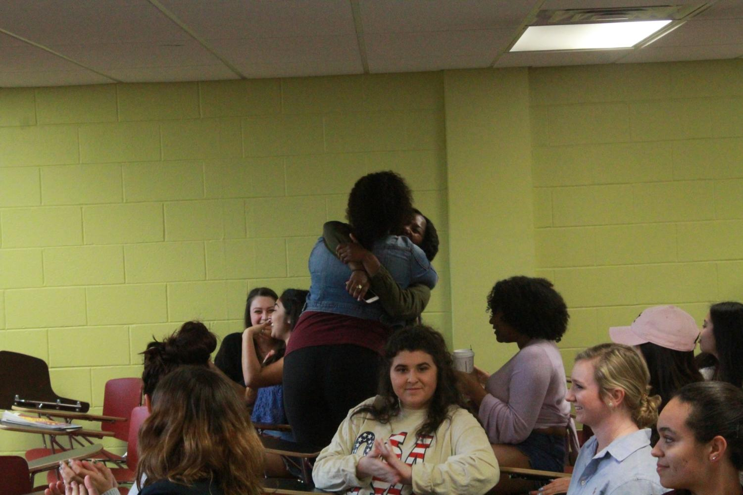 Sierra Ambrose and Joann Cassama share a hug after winning the SGA election on March 21, 2018.