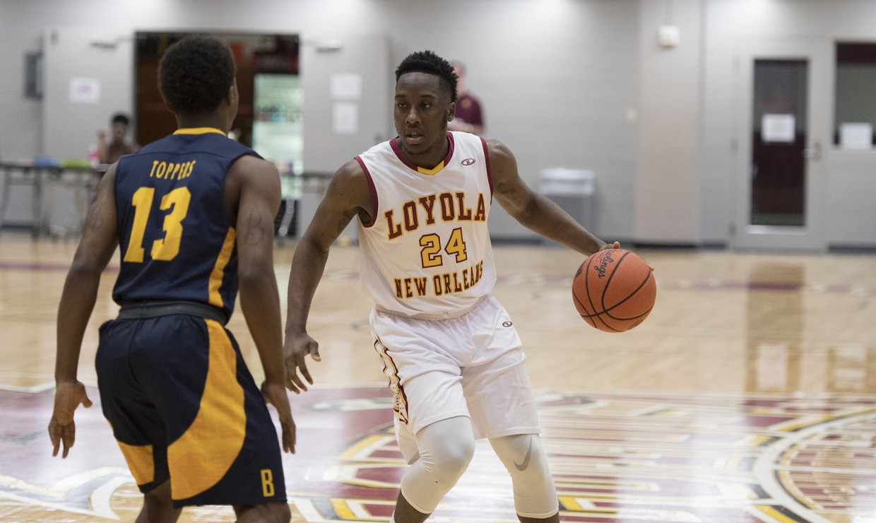 Tre'Von Jasmine (24), computer science junior, posting up a player from Blue Mountain College at The Den Feb. 24 2018. The Loyola men's basketball team advance to the conference round of the Southern States Athletic Conference Championship. Photo credit: Loyola University Athletics