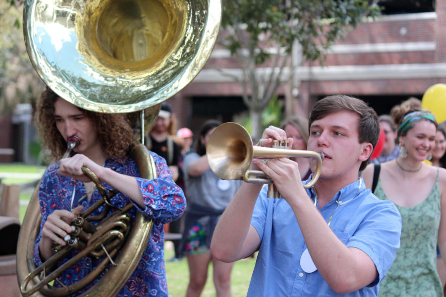 Avery Bell, music education senior, left, and Bryan Maassen, music composition junior, lead a second line during the opening ceremony for the Bateman team's Geaux for the Gold With Purpose campaign Feb. 22, 2018, at the Peace Quad. The Geaux for Gold With Purpose campaign aims to create an official day for the fight against child Cancer. JULES LYDON/Courtesy