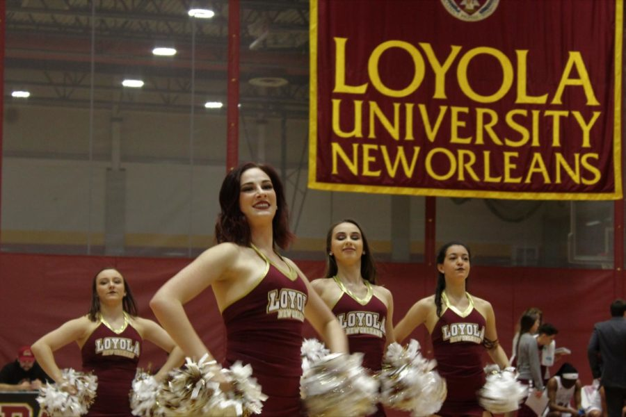Elisabeth Cohen, music industry studies sophomore, leads the Loyola dance team during a halftime performance on Feb. 8 2018. The dance team has won an at-large bid to compete in the national tournament. Photo credit: Andres Fuentes