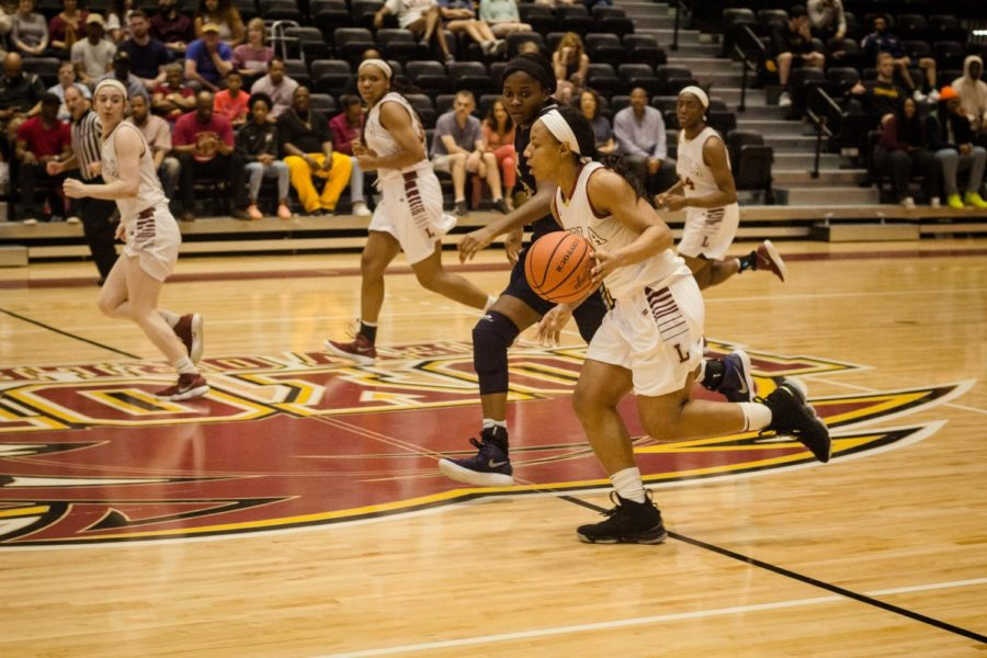Biology senior DiMond Jackson (3) dribbling down the court at a home womens basketball game against Blue Mountain College Feb. 24, 2018. The game honored the teams seniors Jackson and mass communication senior Zoie Miller (10). Photo credit: Julia Santos