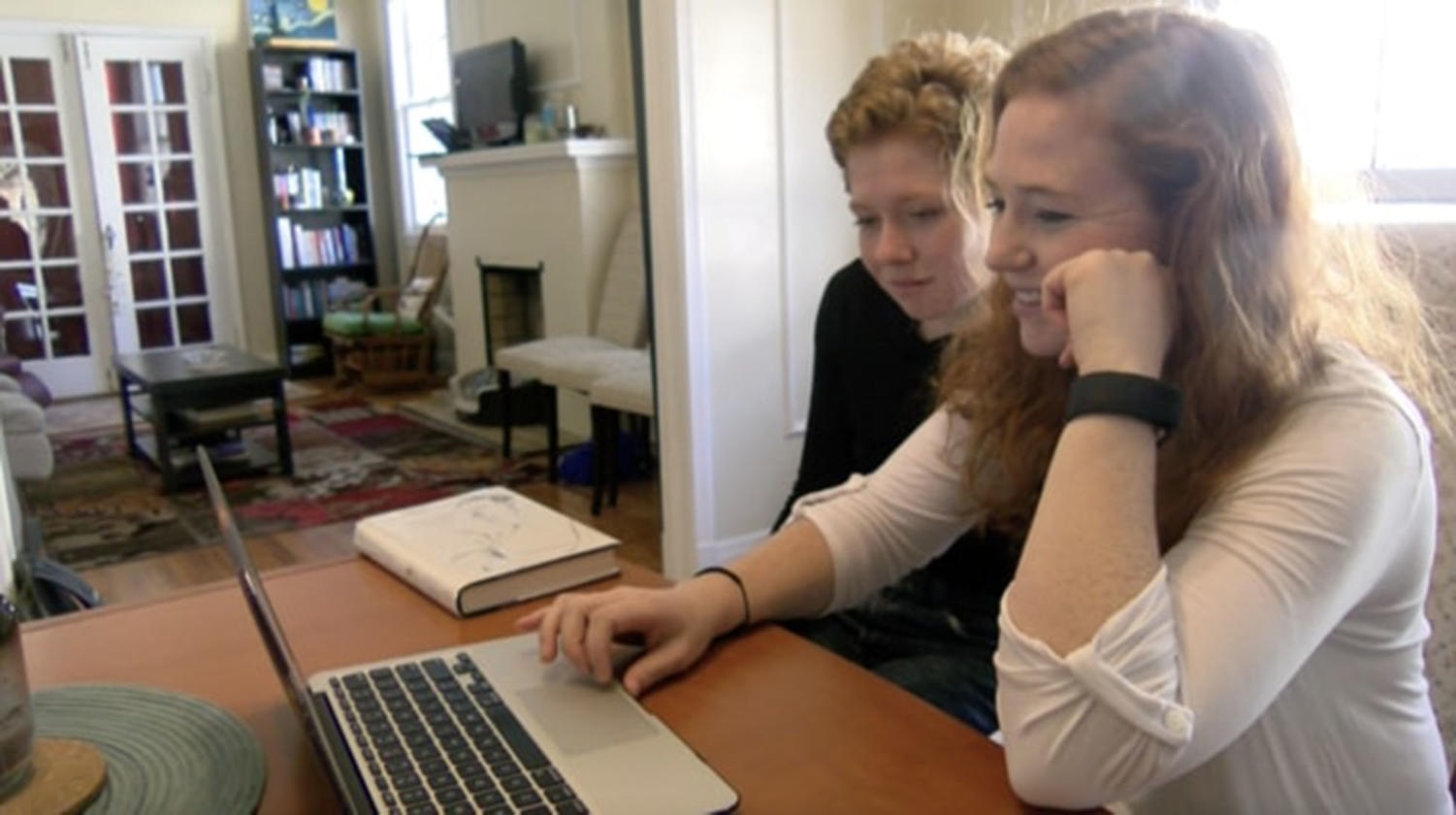 Bess Baria, environmental studies sophomore,  (left) and her sister Merrit Baria, marketing and psychology double major, (right) scroll through Facebook family photos March 7, 2018, in their off-campus apartment. Their father, David Baria announced his candidacy for the midterm U.S. Senate election in Mississippi in November. BRIAN WOLLITZ/ The Maroon.