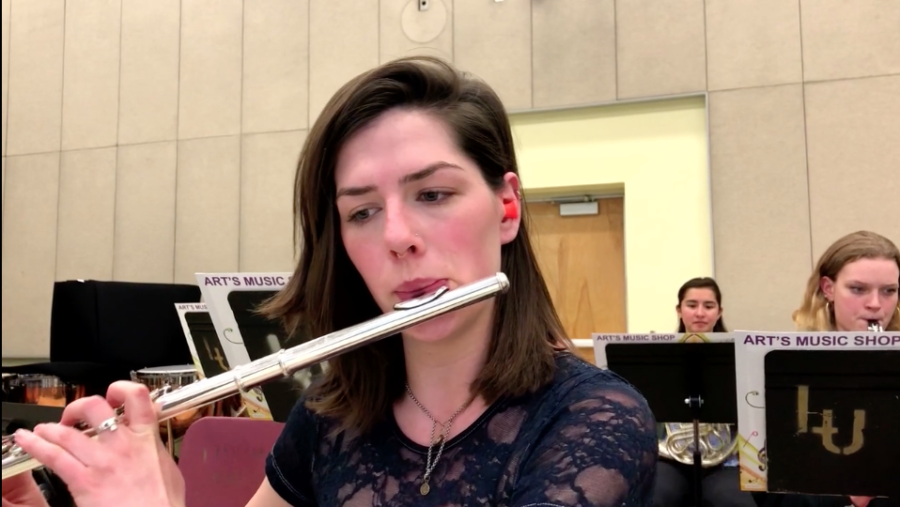 Allison Hasson plays the flute during her rehearsal at Loyola on March 8, 2018. Hasson plays with earplugs at each rehearsal. ANNA KNAPP/The Maroon. Photo credit: Anna Knapp