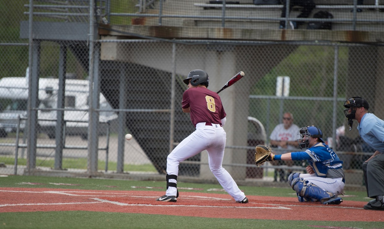 Payton Alexander (8), biology freshman, at the plate. Alexander hit a 7th inning home run versus Spring Hill College as the baseball team splits the doubleheader. Photo credit: Loyola University Athletics